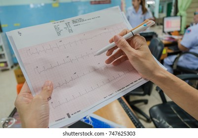 Heart analysis, electrocardiogram graph (ECG) in hand doctor at the hospital .