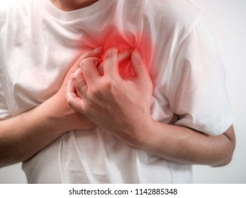Heart attack concept. Man suffering from chest pain on white background, Health care