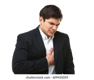 Heart attack concept. Young man suffering from chest pain on white background