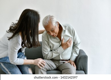 Heart attack disease problem in old man, Elderly asian man with hand on chest gesture, Daughter frighten and worry about her father chest pain symptom, Senior healthcare insurance concept.