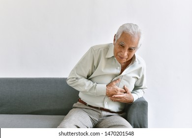 Heart attack disease problem in old man, Elderly asian man with hand on chest gesture, Senior healthcare insurance concept.