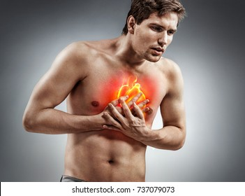 Heart attack. Man holding hand on painful chest. Medical concept.
