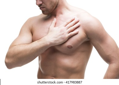 Heart attack. Young muscular man with chest pain isolated on white background. Middle part of the body