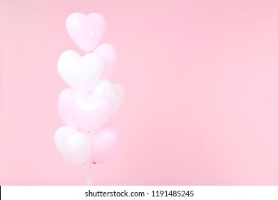 Heart balloons on pink background