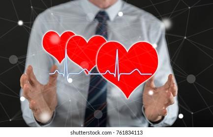A heart beats graph concept between hands of a man in background