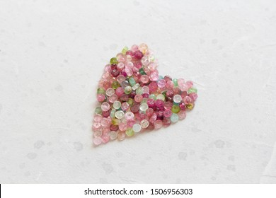 Heart. Beautiful heart made of natural stone tourmaline. Heart on a white background. Greeting card for Valentine's day. Declaration of love. Copy space for your text.