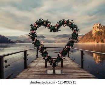 Heart of Bled. Bled sightseeing point with heart, decorated with Christmas decoration. Sunny view of Lake Bled, Slovenia