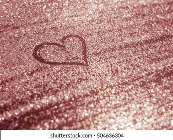 Heart with blurred-bokeh light background from diamond dust glitter.