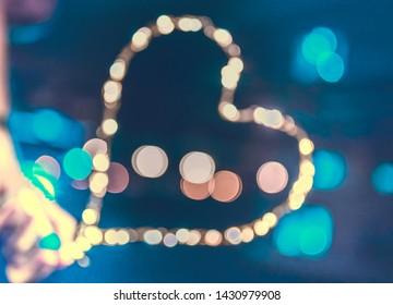 heart bokeh lights shining in fornt