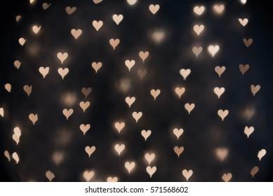 Heart bokeh on dark background. Valentine's Day Background.