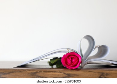 Heart book page and pink rose