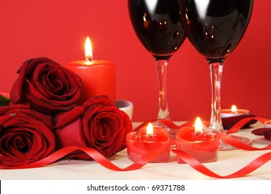 Heart Candles, Red Roses and Wine Romantic Meal Concept