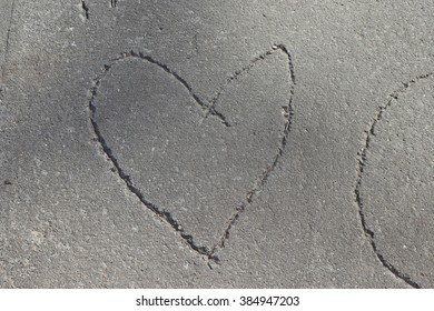 A heart carved into the sidewalk
