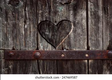 Heart carved in wood. Dark heart. Valentines day background