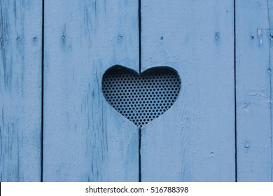 Heart carved in wooden boards, blue