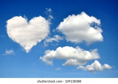 Heart from clouds on blue sky