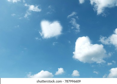 heart clouds on blue sky. Cloudy day.