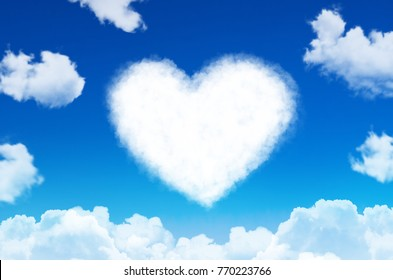 Heart of clouds symbol of love on blue sky