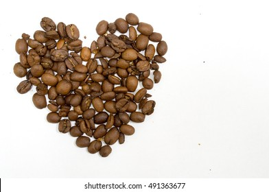 Heart coffee beans isolated on white