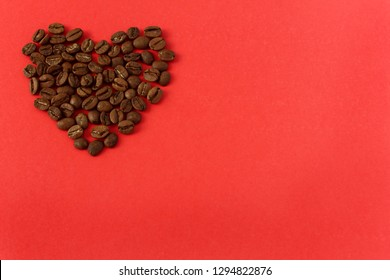 Heart of coffee beans. Heart on a red background. Valentine's Day. Valentines day greeting card.