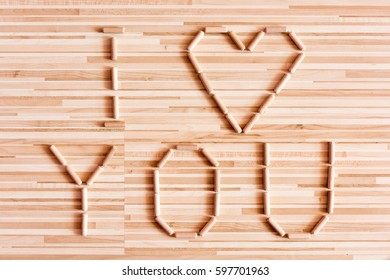 Heart composed wooden dowels on wooden stock photo royalty free heart composed of wooden dowels on wooden background do it yourself home improvement store solutioingenieria Gallery