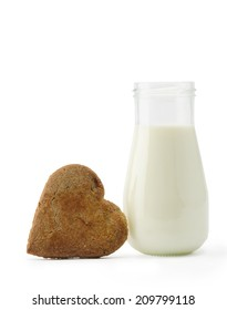 Heart cookie and milk bottle isolated on white background