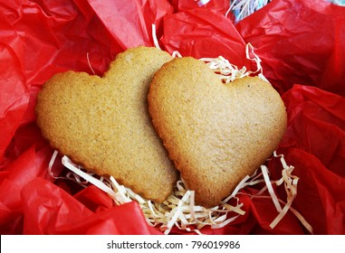 heart cookies on the screwed red paper
