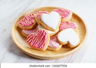 Heart cookies with sweet pink color icing, love concept.