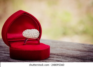 heart dimond love ring in velvet on wood and blur background