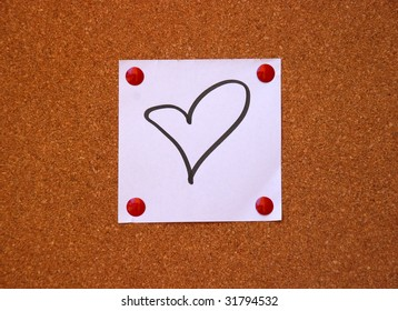 heart drawing on white note pad