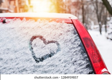 Heart drawn on a car's window. Winter time. Declaration of love on Valentine's day.