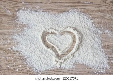 Heart drawn on flour