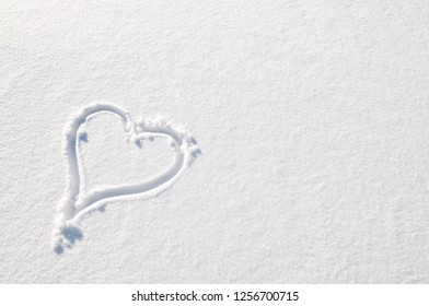 The heart drawn on snow.