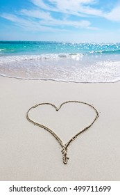 Heart drawn in the sand of tropical sea beach