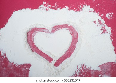 Heart drawn in scattered flour