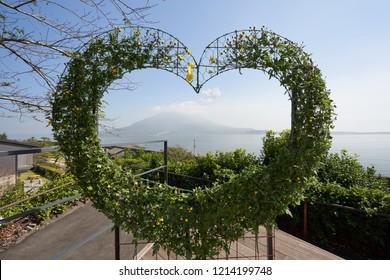 Heart embracing Sakurajima