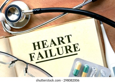 Heart failure concept. Books with stethoscope and.