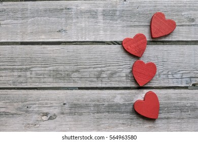 Heart figures over vintage wooden background