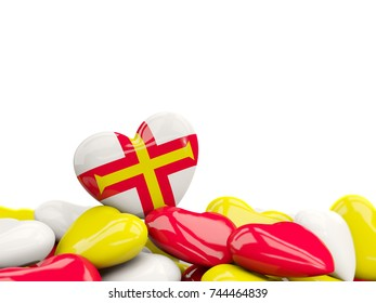 Heart with flag of guernsey on top of colourfull hearts isolated on white. 3D illustration