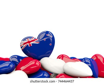 Heart with flag of new zealand on top of colourfull hearts isolated on white. 3D illustration