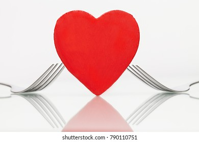 Heart with forks on table. Dinner. Valentine's day concept