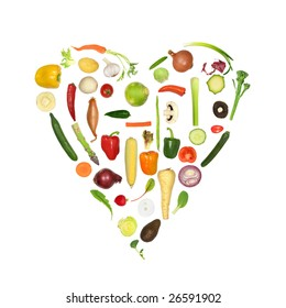 Heart of fresh vegetables, symbolizing a healthy heart, over white background.