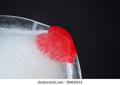 Heart frozen in ice in a black background.