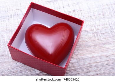 Heart in the gift box isolated on white background
