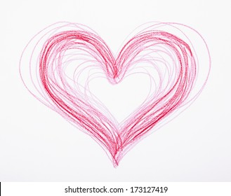 A heart hand-drawn by a child with red crayon. Can represent love, affection, caring, healthcare, Valentine's Day, marriage, dating, the color red, heart health, wear red for women's heart health..