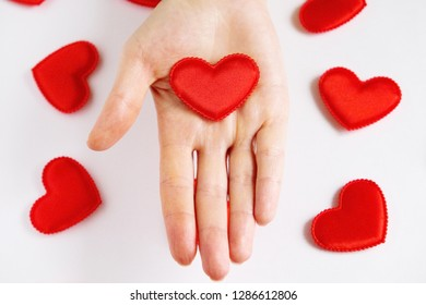 heart. heart hands. heart lying on the palm of the hand. romance. love. Red heart. . St. Valentine's Day. International Women's Day. March 8. Celebration. March 8 background. March 8 greeting card