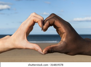 Heart hands Multicultural  hands male and female in heart shape at beach love peace togetherness