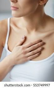 Heart Health Care. Closeup Of Young Woman Feeling Strong Pain In Chest. Close-up Of Female Body With Hand On Chest. Girl Suffering From Painful Feeling, Having Health Issues. High Resolution Image