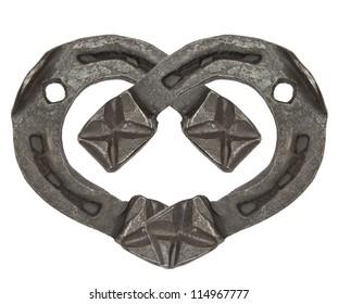 the heart of horseshoes isolated on white background