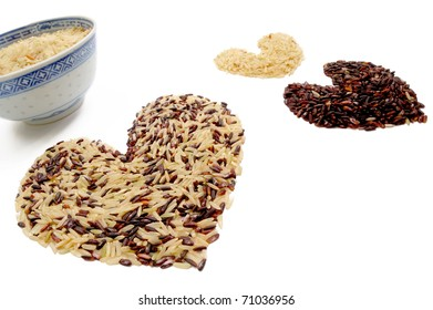 Heart indica rice and chinese bowl on white background